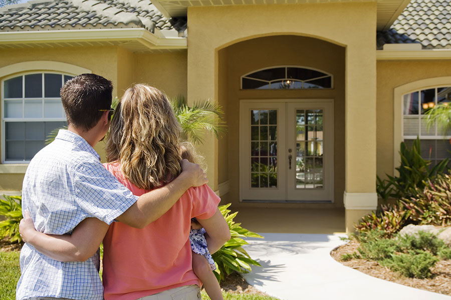 Personal Insurance - View of Young Couple Looking at Their New Home